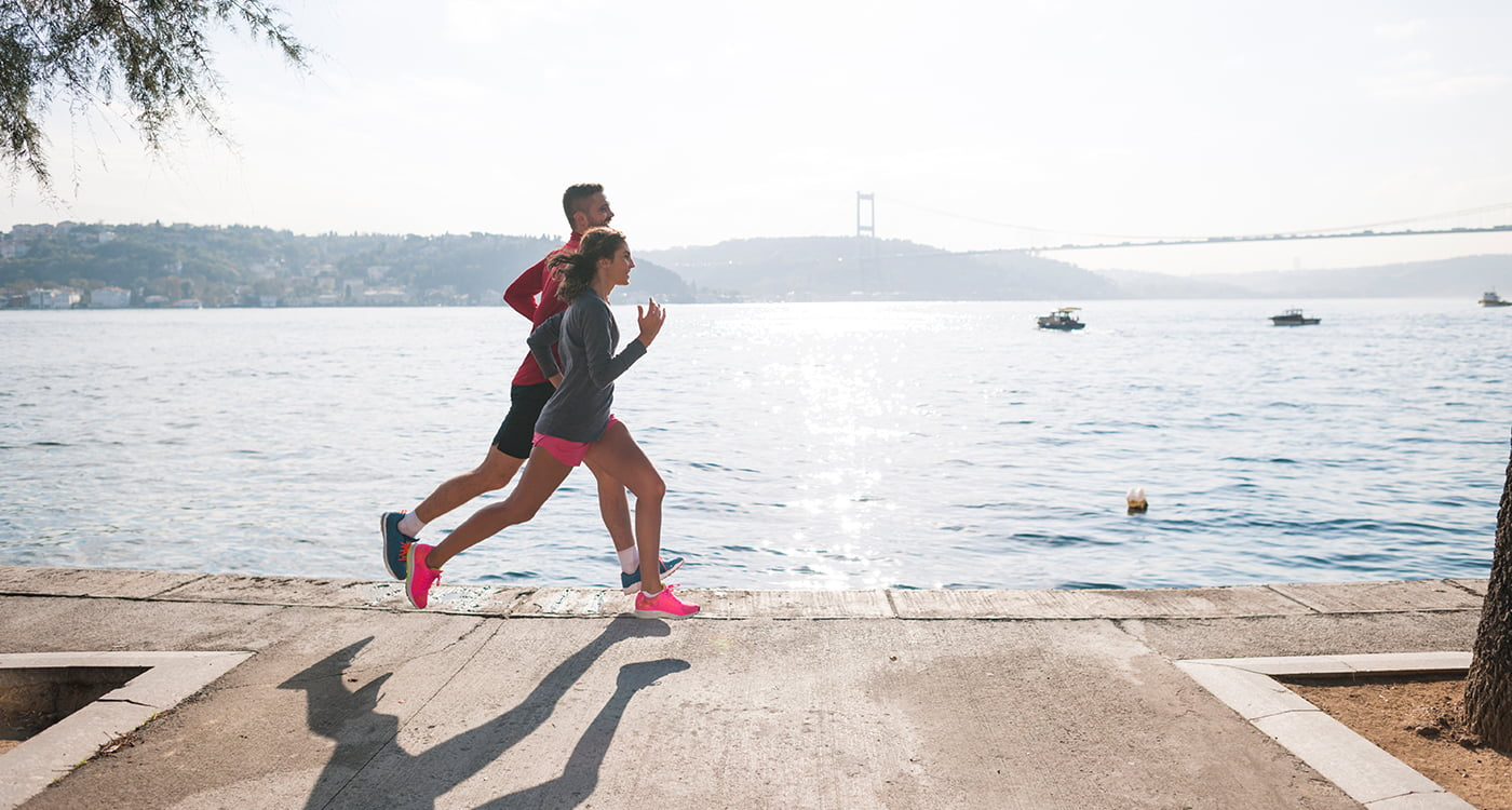 a man and a lady running